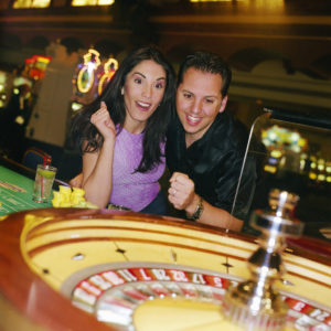 Man and Woman Playing Roulette